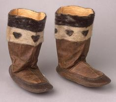 Pair of sealskin fur boots with heart design round top. Kamiik, Cape Dorset, West Baffin Island