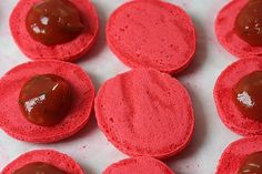 macarons filled with ketchup and cornichons