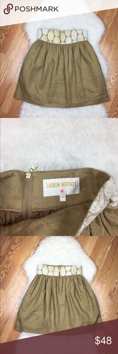 "Lauren Moffatt Linen Skirt 100% linen skirt with cotton trim (at waist). Back zip closure and pockets marked with gold embellishments (shown in pic). In good preowned condition.  Measures 14"" waist (laying flat) and 21"" length. Anthropologie Skirts"