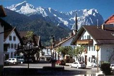 Garmisch-Partenkirchen is an attractive town with wide streets and typically Bavarian architecture. Like all the towns in this region, it lies in a valley between high mountains.