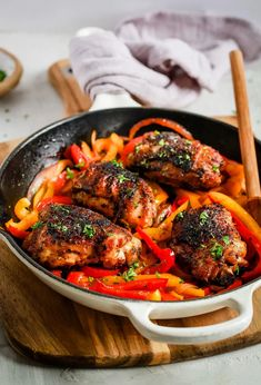 Chicken and Bell Peppers Skillet is one of those dishes that will go to your family dinner rotation because it happens to please everyone. It's seasoned with lots of spices and it's also low-carb, paleo, and whole30 friendly. #chickenandbellpeppers #chickenthighsrecipe Healthy Chicken Recipes, Salmon Recipes, Cooking Recipes, Whole30 Recipes, Chicken Bell Pepper Recipes, Kitchen Recipes, Turkey Recipes, Diabetic Recipes, Yum Yum Chicken