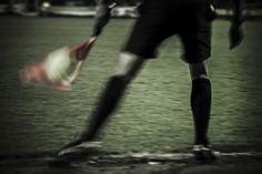Linesman at Swindon Town FC evening match.