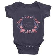 This personalized short-sleeve baby onesie is soft, comfortable, and made of…