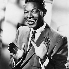 Nat King Cole.  He was before my time but I have his music.  A great voice he had so much so that you could listen to him and all your troubles are forgotten.  Wonderful.