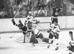 Bruins defenseman Bobby Orr flies through the air in this iconic photo after scoring the series-winning goal in the 1970 Stanley Cup Final against the St. (AP) GALLERY: Iconic Photos of the Boston Bruins Hockey Teams, Hockey Players, Ice Hockey, Hockey Stuff, Boston Sports, Boston Red Sox, Bobby Orr, Boston Bruins Hockey, Nhl News