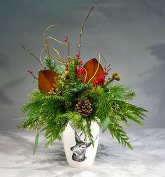 Festive arrangement in a ceramic reindeer vase.