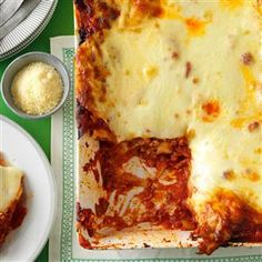 Hearty Sausage and Cheese Lasagna Recipe -During the holidays, it's nice to welcome friends and family into your home for a hearty meal of lasagna. Every bite is packed with cheese, sausage and sauce. —Gay Barker, Chanute, Kansas