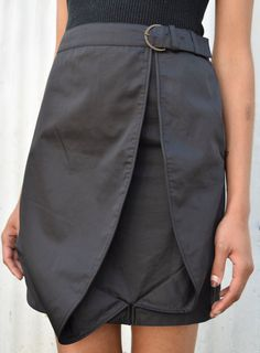 Incredible 1990s Hussein Chalayan minimalist cotton & silk mini skirt. Features a mid waisted cut, a belt closure and avant garde piped pleat detail. Perfect paired with a bodysuit or turtleneck.  Waist: 32″ Hips: 37″ Length: 20″ Era: 1990′s Est. Size: S/M depending on preference of fit Brand: Hussein Chalayan. Made in Italy Material: Silk/Cotton Blend Condition: Great. No Visible Flaws.
