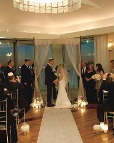 Gotta figure out how to create a non-chuppah chuppah for our ceremony space