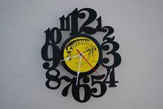 vinyl record clock artist is Superman by vinylclockwork on Etsy, $23.00
