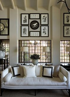 The monochromatic groupings of art above the windows emphasize the unique architecture...
