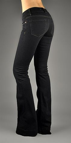 """J BRAND dark washed jeans brings back flairs with a hint of stretch giving your elongated legs freedom from the skinny.- Five pockets- 34.5"""" inseam 8"""" rise 13.5"""" back rise 22"""" leg opening- Cotton/ Polyester/ Spandex blend- Machine wash cold- Made in the U.S.A."""