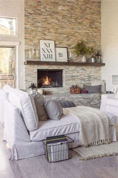 Stunning floor to ceiling tile fireplace wall - this home is gorgeous! eclecticallyvintage.com