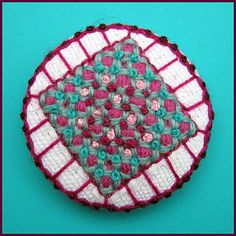 Embroidered button/brooch | Button stitched with wool. | Flickr