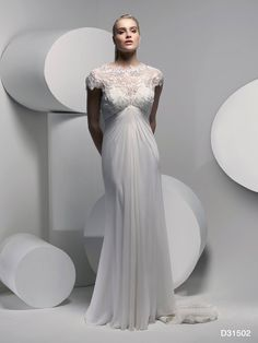 Veromia Ltd added 2 new photos. Such a beautiful dress from the new D'zage collection, with just the right amount of sparkle to set off an amazing neckline. ‪#‎weddingdress‬ ‪#‎bride‬ ‪#‎dzage‬ ‪#‎wedding‬