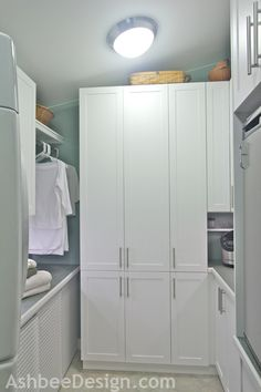 cabinets (Ikea hack?) and bar for haning.   Ashbee Design: Laundry Room Reveal!!!!