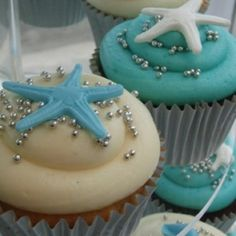 cupcakes decorated in nautical/coastal colours with starfish, starfish @Amanda Wheatley and @Whitney Schafer  --the more elegant  I'd rather use cream chesse mints than fondant
