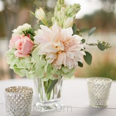 Romantic wedding with short, simple centerpieces