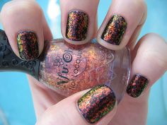 Oil effect A chunky rainbow-esque lacquer over black nails.