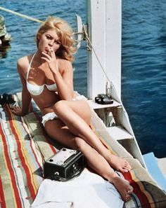 Brigitte Bardot     Can't wait to do this this summer. Just smoke a cigar in a bikini on a boat. Sounds perfect.