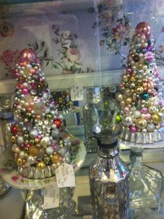 I saw these shabby chic Christmas trees in a store window!  Loved them but they were $100. each!