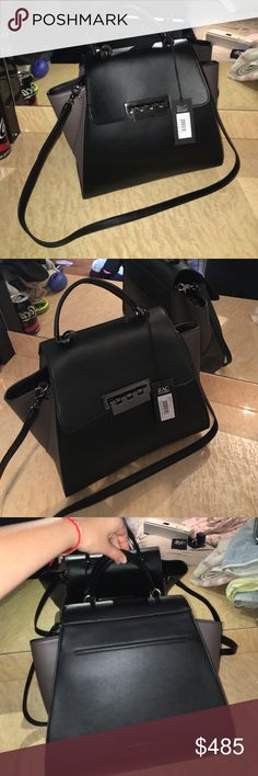Zac Zacposen Black Eartha top handle Bag This purse is fantastic! Never worn brand new with tags. S/n : zp1260-001 Eartha top handle black leather bag.  This bag, is classic, even when it comes down to the shape. Intertier has a couple of slots inside for storage. Final sale!  This bad has a handle and and over the shoulder strap that you can change up. Zac Posen Bags Totes
