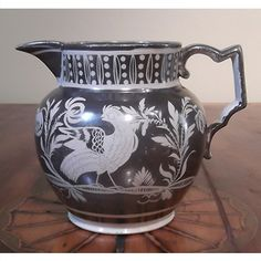 """Rare Leeds Circa 1805 Silver Lustre Pitcher. This very early Georgian silver lustre 'resist' pitcher features birds and flowers and is 4 1/2"""" in height (11 cm.) Leeds did not mark its early pieces. The jug was obtained from a collector and is in excellent condition with no chips or cracks, a rare find. Some of the silver luster is only slightly worn in places which is highly unusual for such an early circa 1805 pitcher."""