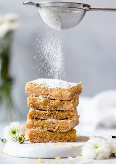 Pucker Up! These sweet honey and tangy lemon bars are lighter than traditional lemon squares, but are not lacking in flavor! The sweet and tart topping is made