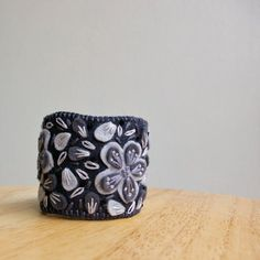 Embroidered felt applique cuff