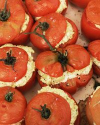 Oven-Roasted Tomatoes Stuffed with Goat Cheese | For these buttery-soft roasted tomatoes, Alain Coumont boosts the flavor of the creamy goat cheese filling with garlic and basil. The result works both as a side dish or a main course with a salad and crusty bread.
