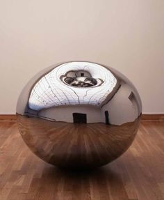 Anish Kapoor's 1995 stainless steel sculpture Turning the World Inside O