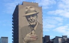 A 22-story tall portrait of Leonard Cohen on the side of a building on Montreal's Crescent Street. (Robert Sarner/Times of Israel)