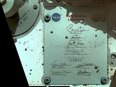 President's Signature On Board Curiosity. This view of Curiosity's deck shows a plaque bearing several signatures of US officials, including that of President Obama and Vice President Biden. The image was taken by the rover's Mars Hand Lens Imager (MAHLI) during the rover's 44th Martian day, or sol, on Mars (Sept. 19, 2012). The plaque is located on the front left side of the rover's deck.