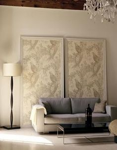 Frame large panels of wallpaper.  Lean against wall.  Major impact - no commitment - no wall prep.  I love this.