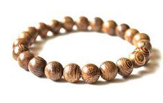 Natural siamese wood stacking bracelet. $22.00, via Etsy.