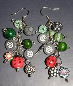use small slices and leaves on chain dangle earrings......................................34556_1530103573724_1268776087_31493375_1525591_n by Orson's World, via Flickr