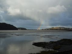 From left to right: Benarth Head, Conwy Bridge(s), Deganwy (rainbow's end), The Mount of the ancient Welsh Castle of Deganwy, The Great Orme Llandudno in the rain ahower, and in the foreground the tidal estuary of the Conwy River which is a bird sanctuary and protected site. Between this and the Great Orme is Llandudno Junction. That seagull is there again!  27DEC2014. 12.20pm. Jp.photo.