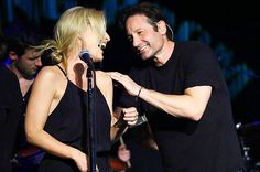 """Yesterday (May 12) marked the release of David Duchovny's debut album, a folk-rock set titled """"Hell or Highwater."""" Performing last night at New York's Cutting Room, Duchovny stayed on that musical wavelength, covering an old Crosby, Stills, Nash, and Young song with X-Files co-star Gillian Anderson."""