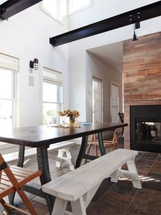 Love this dining table with mismatched chairs and benches