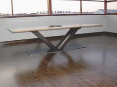 Industrial modern dining table with reclaimed steel i-beams and wood