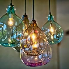 Five Round Glass Pendant Lights in Different Colors