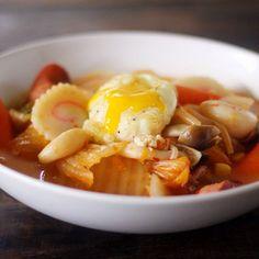 Tempura-fried soft-boiled egg on @pretentiousratbadger's amazing kimchi jjigae. by eggoftheday