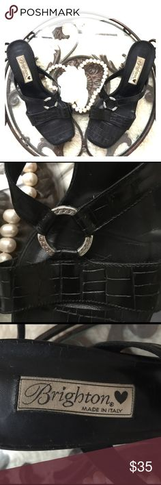 """{Brighton} """"Terry"""" Black  Leather Made in Italy Classics never go out if style. And thats why you will want to add these to your shoe collection. Year after year they will be in style. Pre-loved, Made in Italy fine crafted in the Brighton way. Croco Leather sandal with O link silver medallion with heel that measures, 2.5' tall. #brighton,#brightonterry, #brightonsandal Brighton Shoes Sandals"""