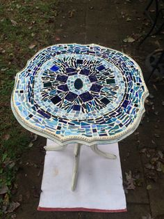 Shabbby chic finished table with blue and white glass mosaic design by LuantiMosaics on Etsy https://www.etsy.com/listing/249823568/shabbby-chic-finished-table-with-blue