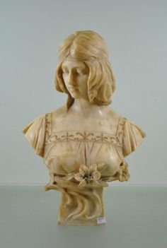 Art nouveau alabaster bust of a young woman on a small waisted pedestal by Belgian sculptor Antonio Frilli (1873 - 1927). (likely Jeanne d'Arc)