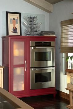 Built in ovens in a hutch surround.  Frosted glass. Oasis Platinum door style.  maple Cayene Vintage finish.  Smart and fresh.
