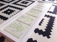 Clay sibling hand impressions. Each handprint plaque has been crafted, hand painted and personalised and set in a beautiful white shadow box frame.