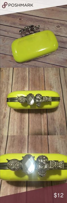 New Never Used Skull Ring Clutch Bag New Never Used Skull Ring Clutch. Color:Neon Yellow. Purchased As Is From Call It Spring With Slight Discoloration On Sides. Sz: 7 1/2 x 3 1/2. Chain Strap Included. Too Cute To Pass Up!!! Call It Spring Bags Clutches & Wristlets