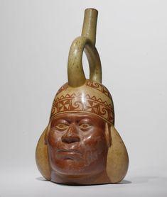 Moche IV Portrait head stirrup-spout vessel,  ca. A.D. 450-550  Estimate  5,000 — 8,000  USD   LOT SOLD. 12,500 USD