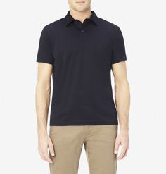 Discover a simple, elegant black polo shirt design made in a light, soft, high quality cotton fabric, from vintage English menswear company Sunspel.